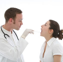 tonsillitis - dr. looking into patient's mouth image