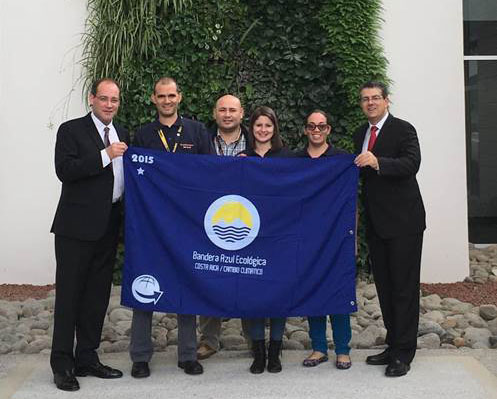 Costa Rica employees holding blue flag
